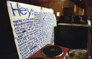 "handwritten ""clean up your mess"" sign at Speak in Tongues"
