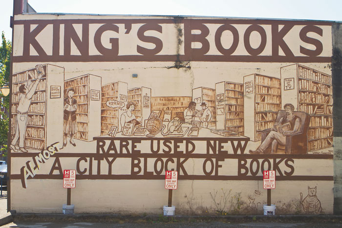 The giant mural on the wall of King's books