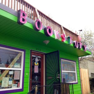 microcosm publishing storefront with bookstory sign