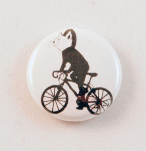 button with a cat riding a bike in a hoodie