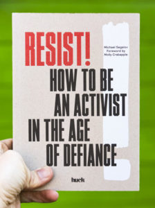 The cover of Resist! which has a plain light brown background with a white exclamation mark.
