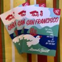 This is San Francisco books fanned out over a colorful tablecloth