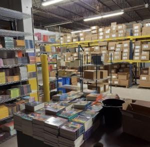 An industrial room full of books on metal shelves