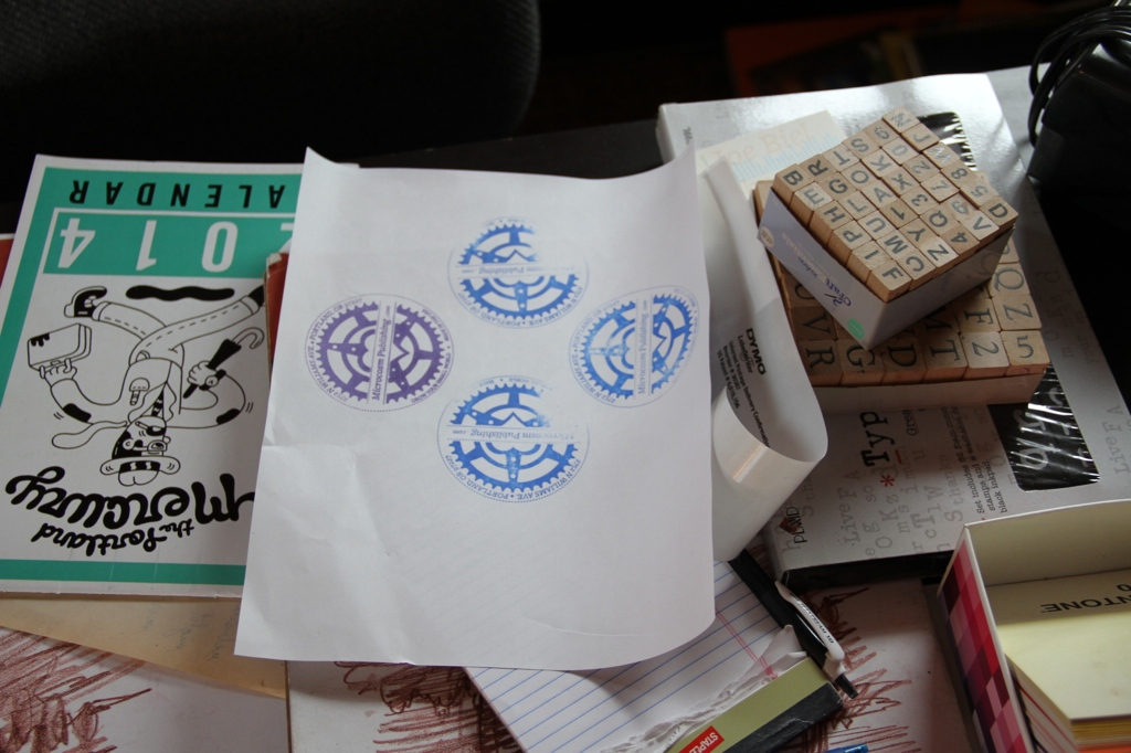 Stamping our logo on a piece of paper