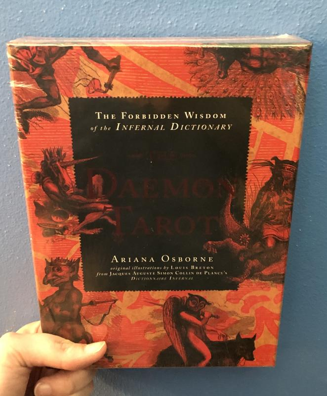 Illustrations of demonic creatures cover the background in red and black, with a black rectangle in the center of the cover.