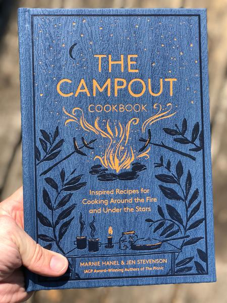 blue cover with illustration of campfire