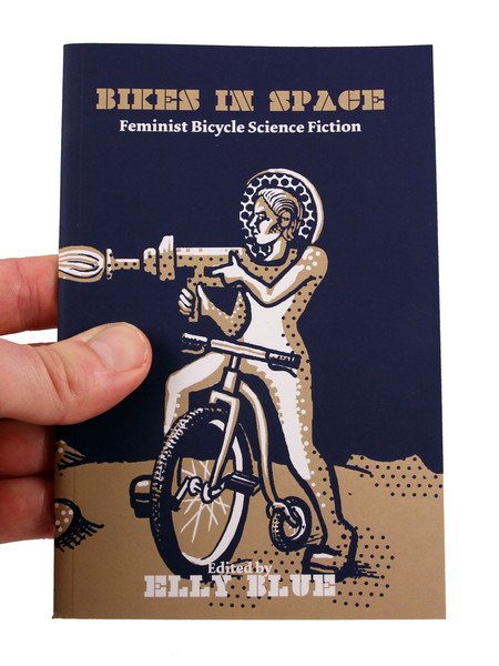 A woman in a space suit, on a bike, with a weapon, on an alien surface