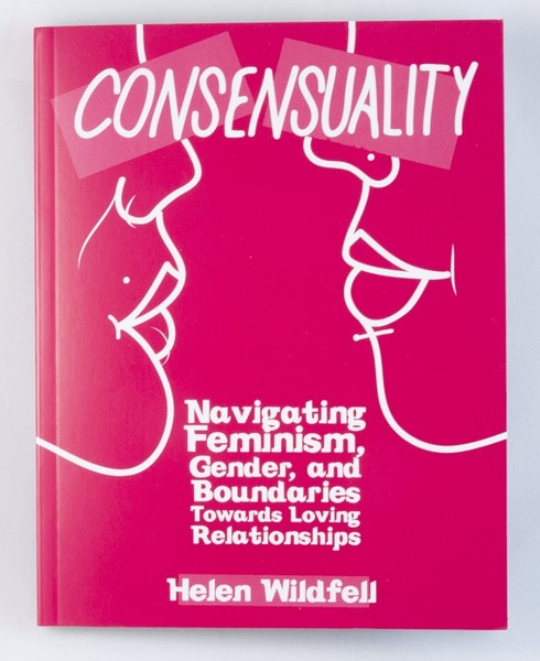 A pink book with the outlines of two women's faces facing one another