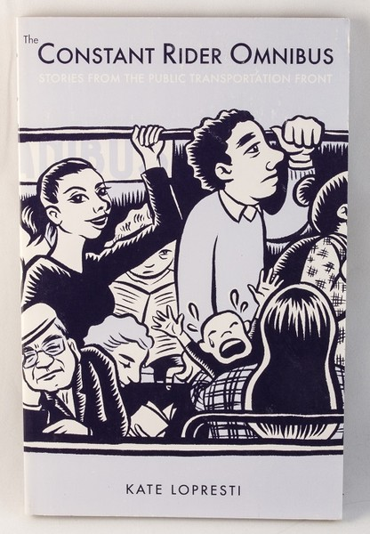 A book with an illustration of people riding a very crowded bus