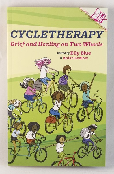 A green book cover with an illustration of several different women bicycling over a grassy hill