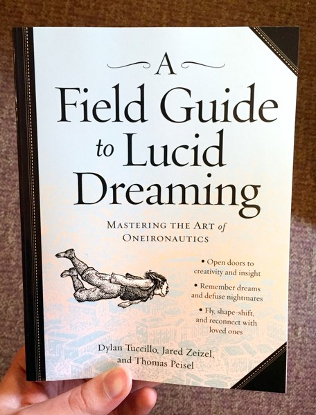 Cover of a field guide to lucid dreaming which features a ink drawing of a person flying through the air