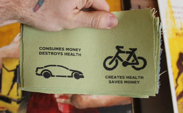 Canvas patch with car and bike slogans