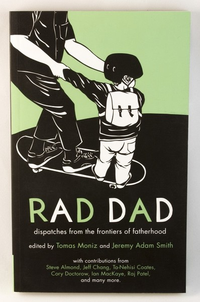 A zine cover with an image of a child holding their dad's hands, both on a skateboard