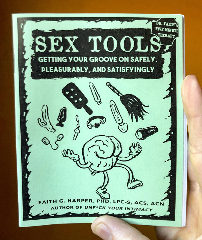 a zine cover with an illustration of a brain juggling sex toys