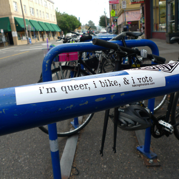 """i'm queer, i bike, and i vote"" sticker"