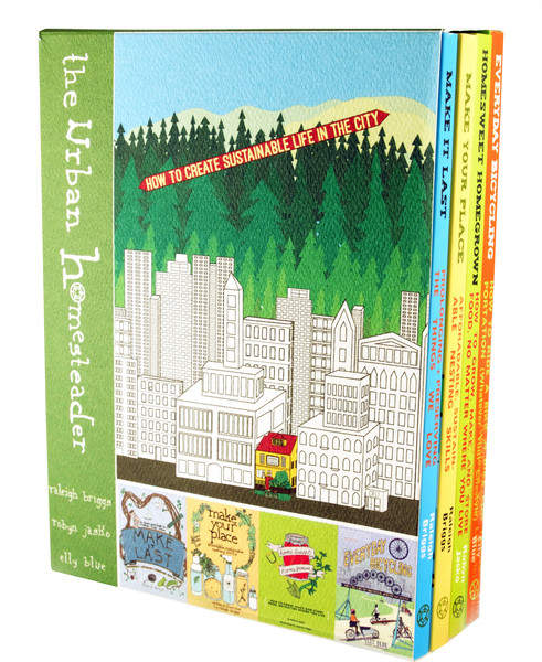 a box set of books with an illustration of a city surrounded by trees (Portland)