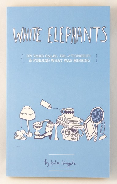 A light blue book cover with illustrations of a small, white elephant, a lamp, a tennis racket, some books, a shoe, and a mug